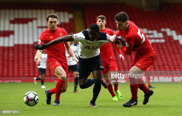 Shilow Tracey of Tottenham Hotspur battles with Corey Whelan and Connor Randall of Liverpool during the Premier League 2 match between Liverpool and...