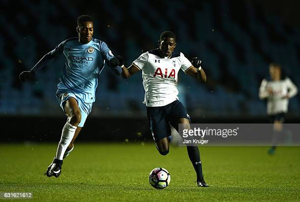 Shilow Tracey of Tottenham Hotspur battles with Tosin Adarabioyo of Manchester City during the Premier League 2 match between Manchester City and...