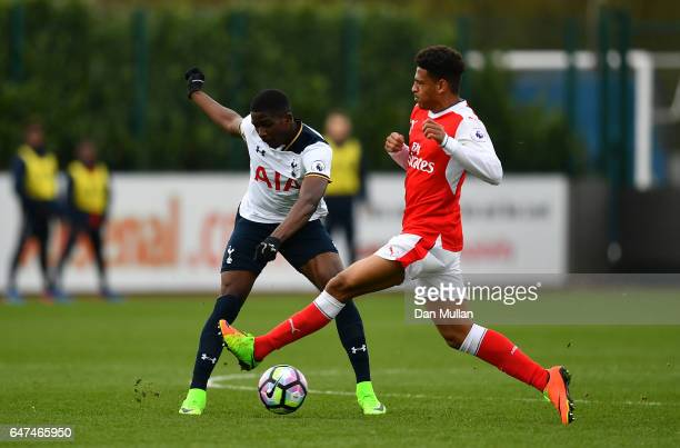 Shilow Tracey of Tottenham Hotspur holds off Cohen Bramall of Arsenal during the Premier League 2 match between Arsenal and Tottenham Hotspur at...