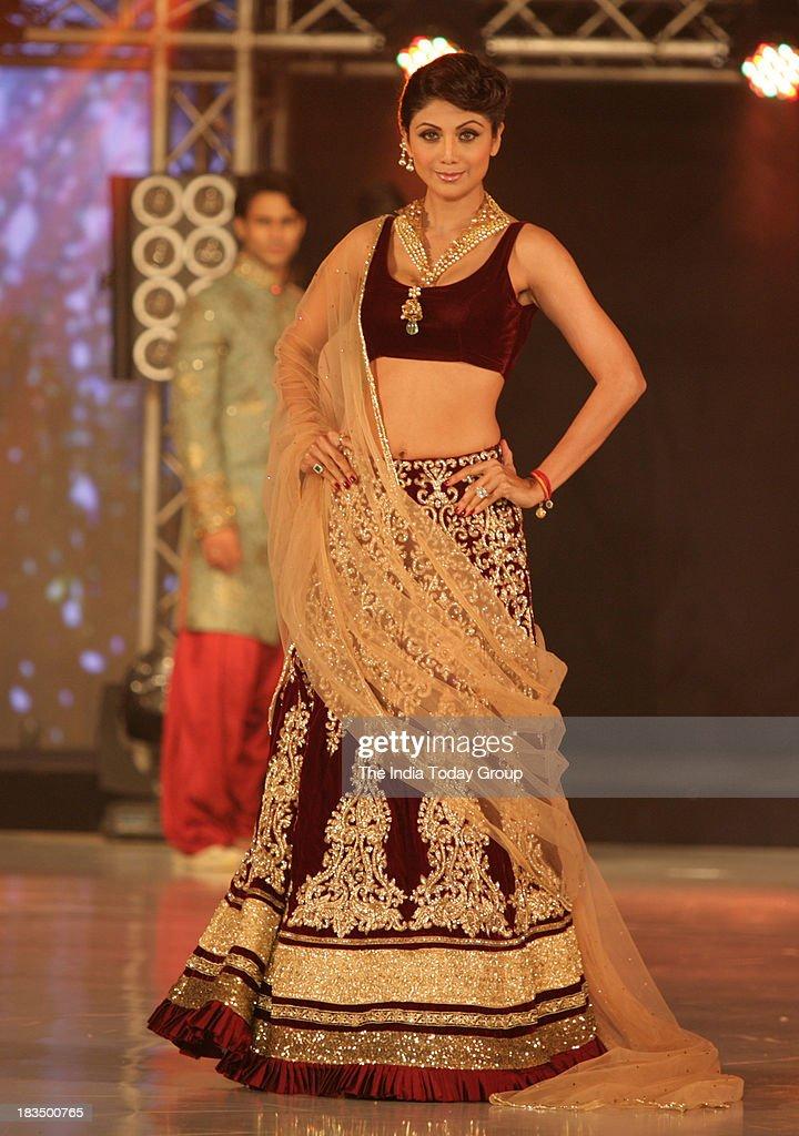Shilpa Shetty walks the ramp during a fashion show organised by India International Bullion Summit showcasing exquisite jewellery.