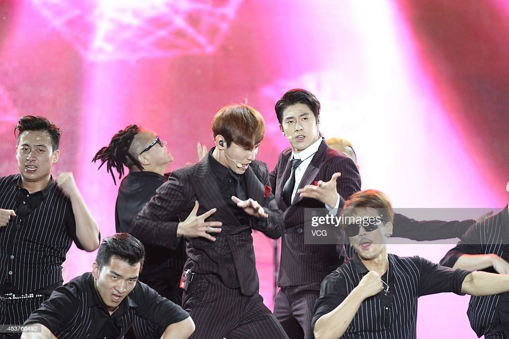 Shim Changmin and Yunho of idol group Tohoshinki performs on stage at 2014 Automotive International Pudong Carnival In Shanghai on August 17 2014 in...