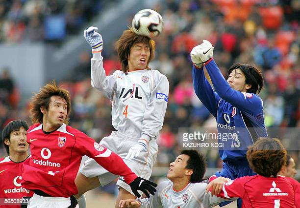 Shimizu SPulse defender Kazumichi Takagi heads the ball over Urawa Reds goalkeeper Ryota Tuszuki in the first half of the Emperor's Cup final at the...