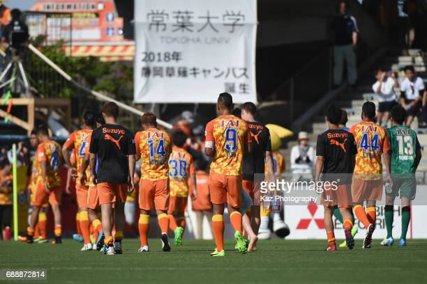 Shimizu SPulse players leave the pitch after their 13 defeat in the JLeague J1 match between Shimizu SPulse and Yokohama FMarinos at IAI Stadium...