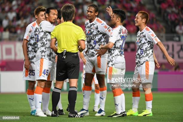 Shimizu SPulse players surround referee Nobutsugu Murakami after Cerezo Osaka is awarded a penalty due to a hand ball by Ko Matsubara of Shimizu...