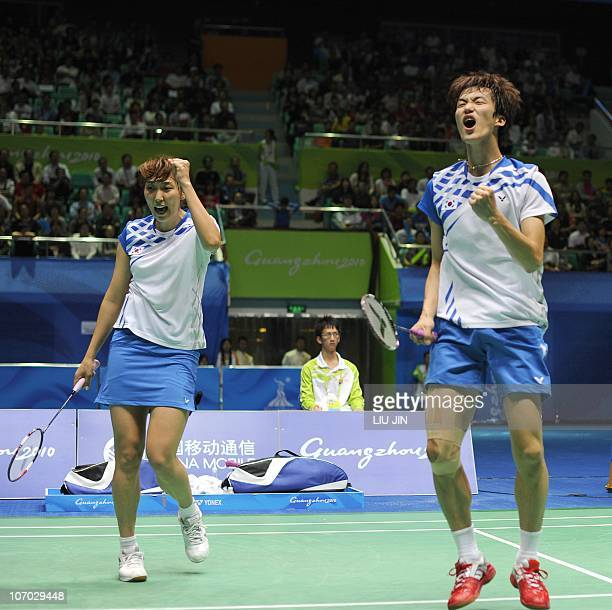 Shin BaekCheol and Lee HyoJung of South Korea react to a winning point against He Hanbin and Ma Jin of China during their mixed doubles badminton...