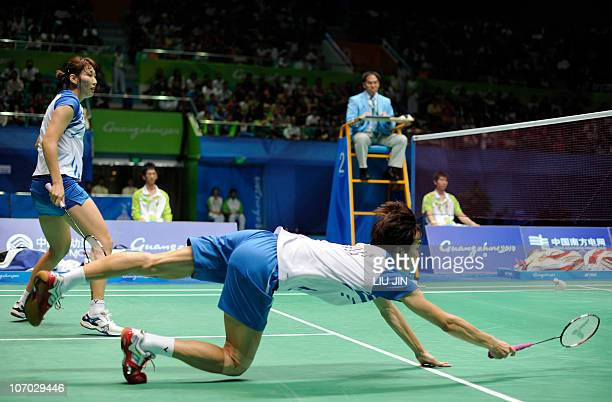 Shin BaekCheol of South Korea reaches to retrieve a shot with his partner Lee HyoJung against He Hanbin and Ma Jin of China during their mixed...