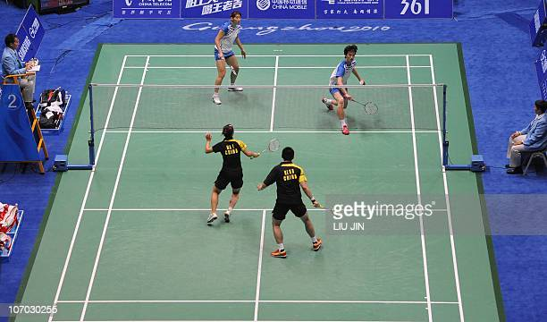 Shin BaekCheol of South Korea returns a shot with his partner Lee HyoJung against He Hanbin and Ma Jin of China during their mixed doubles badminton...