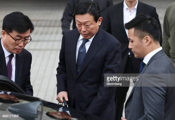 Shin Dongbin chairman of Lotte Group center enters a vehicle as he leaves the Seoul Central District Court for a lunch break in Seoul South Korea on...