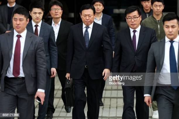 Shin Dongbin chairman of Lotte Group center leaves the Seoul Central District Court for a lunch break in Seoul South Korea on Monday March 27 2017...