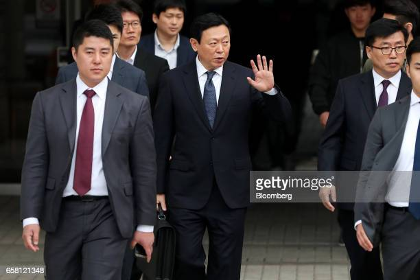 Shin Dongbin chairman of Lotte Group center waves as he leaves the Seoul Central District Court for a lunch break in Seoul South Korea on Monday...