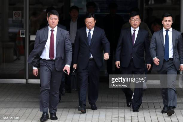 Shin Dongbin chairman of Lotte Group second left leaves the Seoul Central District Court for a lunch break in Seoul South Korea on Monday March 27...