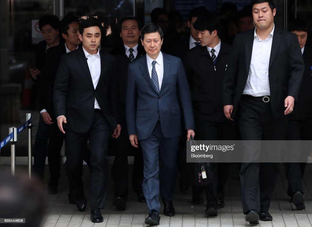 Shin Dong-joo, chief executive officer of Kwang Yoon Sa and former vice chairman of Lotte Group, center, leaves the Seoul Central District Court in Seoul, South Korea, on Monday, March 20, 2017. Lotte Group founder Shin Kyuk-ho and his children denied corruption charges filed against them by South Korean prosecutors as a court in Seoul kicked off criminal proceedings against one of the countrys most powerful corporate families. Photographer: SeongJoon Cho/Bloomberg via Getty Images