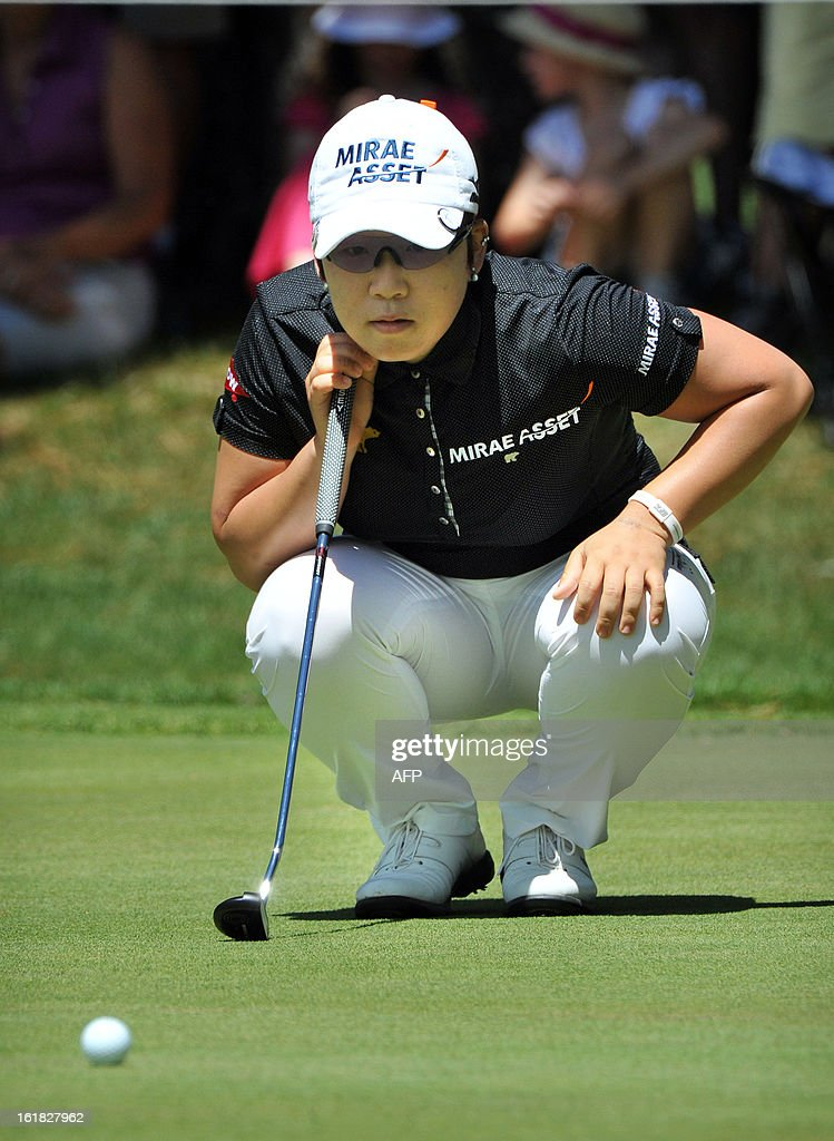 Shin Ji-Yai of South Korea lines up a putt during the final round of the Women's Australian Open golf tournament in Canberra on February 17, 2013. AFP PHOTO / MARK GRAHAM -- IMAGE RESTRICTED TO EDITORIAL USE - STRICTLY NO COMMERCIAL USE