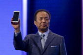 Shin JongKyun chief executive officer of Samsung Electronics Co holds a new Galaxy S5 smartphone during the company's news conference on the opening...