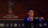Shin Man Gil Executive Director AFC Competitions Division displays a draw for Singapore during 2018 FIFA World Cup Russia Asian qualifiers...