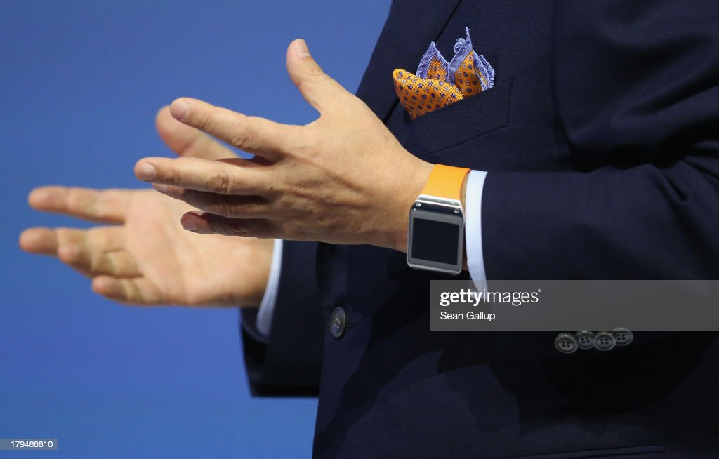 K Shin President and CEO of IT and Mobile Communications Division at Samsung presents the new Samsung Galaxy Gear smart watch at the Samsung Unpacked...