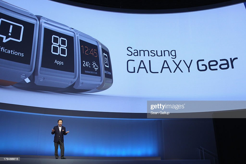 J.K. Shin, President and CEO of IT and Mobile Communications Division at Samsung, presents the new Samsung Galaxy Gear smart watch at the Samsung Unpacked 2013 Episode 2 at Tempodrom on September 4, 2013 in Berlin, Germany. Samsung introduced a total of three new products at the event, on the eve of the IFA 2013 consumer electonics fair.