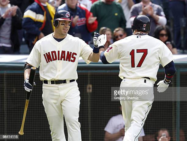 Shin Soo Choo of the Cleveland Indians is congratulated after first inning home run by Travis Hafner while playing the Texas Rangers during Opening...