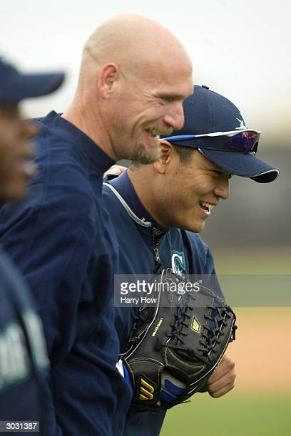 Shin Soo Choo of the Seattle Mariners jokes with Jay Buhner during the 2004 MLB Spring Training Photo Day at Peoria Stadium on February 27 2004 in...