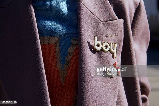Shin Yamada seen at Skylight Clarkson Sq outside the Robert Geller show wearing Paul Smith ankle length coat WLT large knit blue sweater and Hyein...