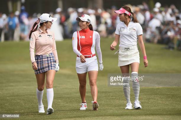 ShinAe Ahn of South Korea BoMee Lee of South Korea and Kumiko Kaneda of Japan walk the 1st fairway during the final round of the World Ladies...