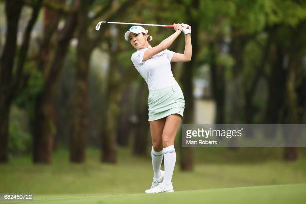 ShinAe Ahn of South Korea hits her second shot on the 11th hole during the first round of the HokennoMadoguchi Ladies at the Fukuoka Country Club...