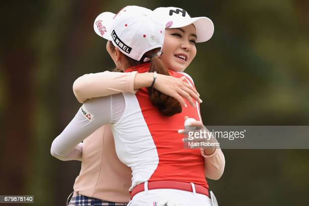 ShinAe Ahn of South Korea hugs BoMee Lee of South Korea on the 18th green during the final round of the World Ladies Championship Salonpas Cup at the...