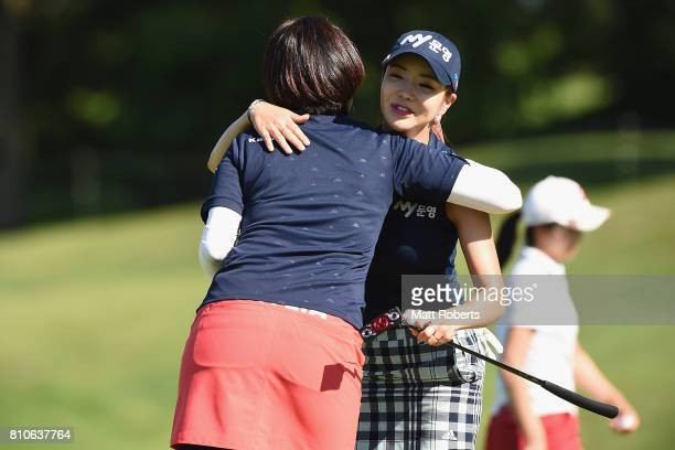ShinAe Ahn of South Korea hugs Shiho Oyama of Japan on the 18th green during the second round of the Nipponham Ladies Classics at the Ambix Hakodate...