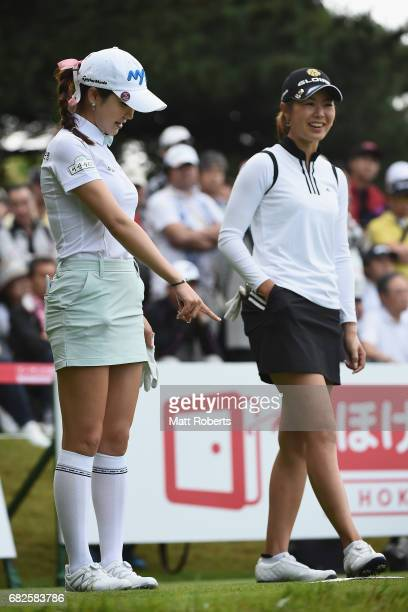 ShinAe Ahn of South Korea shares a laugh with Ayaka Matsumori of Japan before her tee shot on the 10th hole during the first round of the...