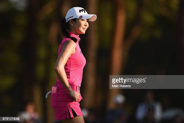 ShinAe Ahn of South Korea smiles on the 18th green during the second round of the World Ladies Championship Salonpas Cup at the Ibaraki Golf Club on...