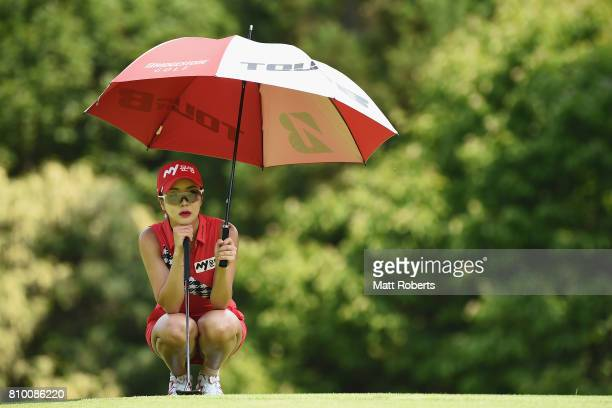 ShinAe Ahn of South Korea waits to putt on the 3rd green during the first round of the Nipponham Ladies Classics at the Ambix Hakodate Club on July 7...