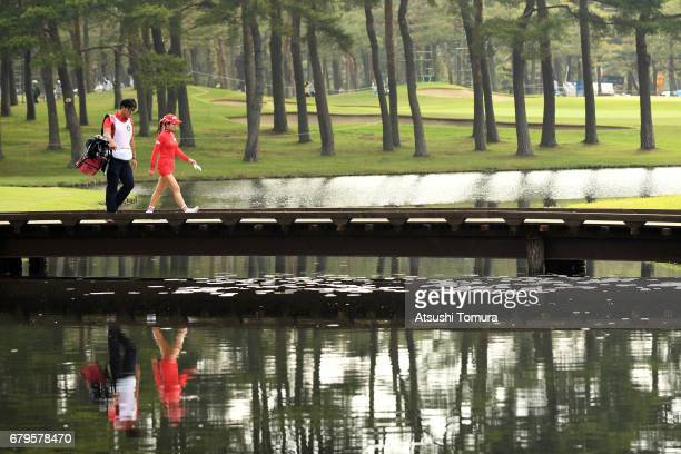 ShinAe Ahn of South Korea walks on the bridge during the third round of the World Ladies Championship Salonpas Cup at the Ibaraki Golf Club on May 6...