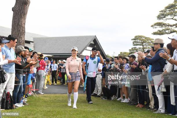 ShinAe Ahn of South Korea walks up to the 1st tee during the final round of the World Ladies Championship Salonpas Cup at the Ibaraki Golf Club on...