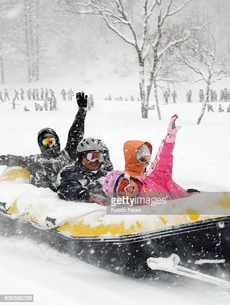 Shinano Japan Photo taken Jan 22 2014 shows people enjoying snow rafting at Tangram Ski Circus in Shinano Nagano Prefecture