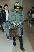 Shindong of boy band Super Junior M is seen upon arrival at the Gimpo Airport on October 28 2013 in Seoul South Korea