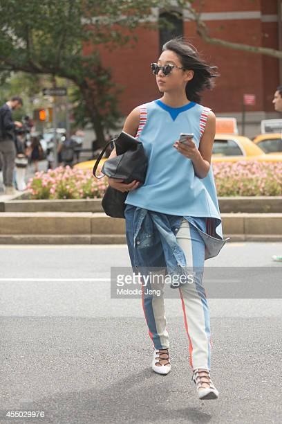 Shine By Three Blogger and Matches Fashion SS15 Guest Buyer Margaret Zhang exits Tommy Hilfiger on Day 5 of New York Fashion Week Spring/Summer 2015...