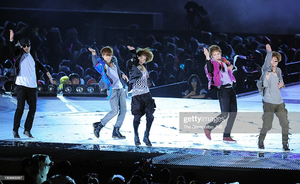SHINee perform during 'SM Town Live World Tour 3 In Seoul' at Jamsil Sports Complex on August 18, 2012 in Seoul, South Korea.