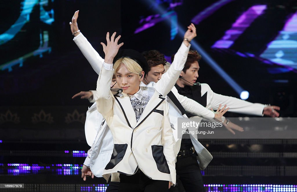 SHINee perform onstage during the 2013 Miss Korea Beauty Pageant at Sejong Center on June 4, 2013 in Seoul, South Korea.