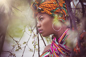 Shines with beauty. African American woman in the park.