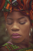 Shines with special beauty. African American woman in the park.
