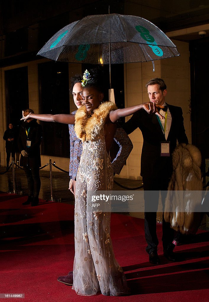 Shingai Shoniwa (C) of British indie rock band the Noisettes arrives for the BAFTA British Academy Film Awards after party in London on February 10, 2013.