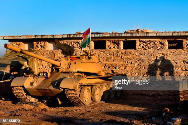 Shingal Regional Government of KurdistanIraq A tank belonging to the peshmerga that took back the city of Shingal A Kurdish flag floating on top of...