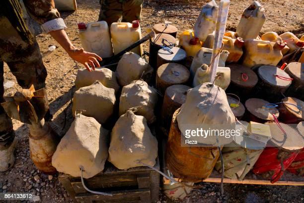 Shingal Regional Government of KurdistanIraq Peshmergas' bomb squad gathering the explosives abandonned by the Islamic State organization to disarm...