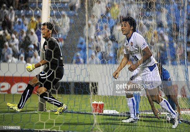 Shingo Akamine of Vegalta Sendai celebrates the first goal while goalkeeper Yoshikatsu Kawaguchi of Jubilo Iwata reacts during the JLeague match...
