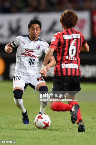 Shingo Hyodo and Hiroshi Kiyotake of Cerezo Osaka compete for the ball during the JLeague J1 match between Consadole Sapporo and Cerezo Osaka at...