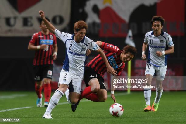 Shingo Hyodo of Consadole Sapporo and Genta Miura of Gamba Osaka compete for the ball during the JLeague J1 match between Consadole Sapporo and Gamba...