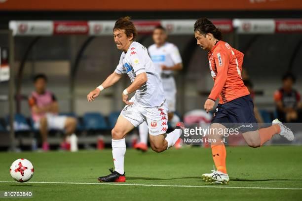 Shingo Hyodo of Consadole Sapporo and Takuya Wada of Omiya Ardija compete for the ball during the JLeague J1 match between Omiya Ardija and Consadole...