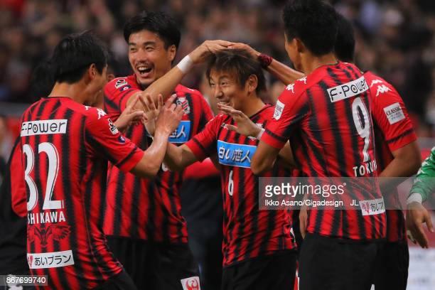 Shingo Hyodo of Consadole Sapporo celebrates scoring his side's first goal with his team mates during the JLeague J1 match between Consadole Sapporo...