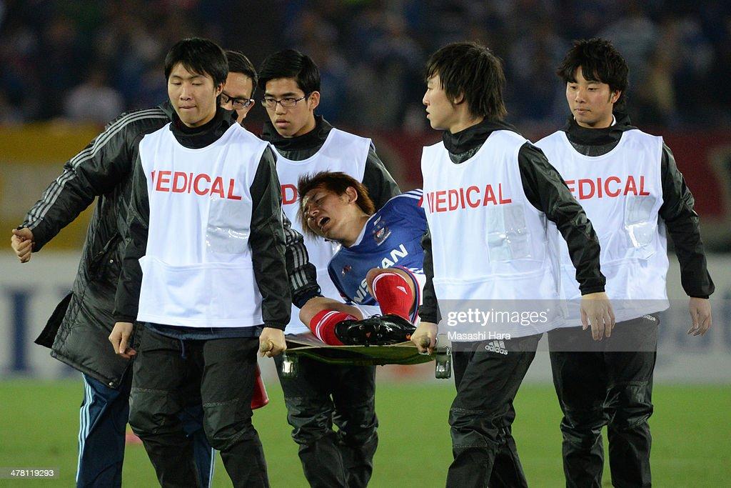 Shingo Hyodo #7 of Yokohama F.Marinos injured during the AFC Champions League Group G match between Yokohama F.Marinos and Guangzhou Evergrande at Nissan Stadium on March 12, 2014 in Yokohama, Japan.