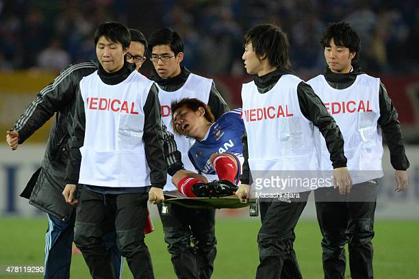 Shingo Hyodo of Yokohama FMarinos injured during the AFC Champions League Group G match between Yokohama FMarinos and Guangzhou Evergrande at Nissan...